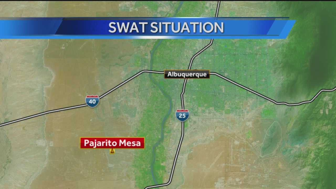Laura Thoren is near the scene of a SWAT team standoff with a man inside a structure at Pajarito Mesa.