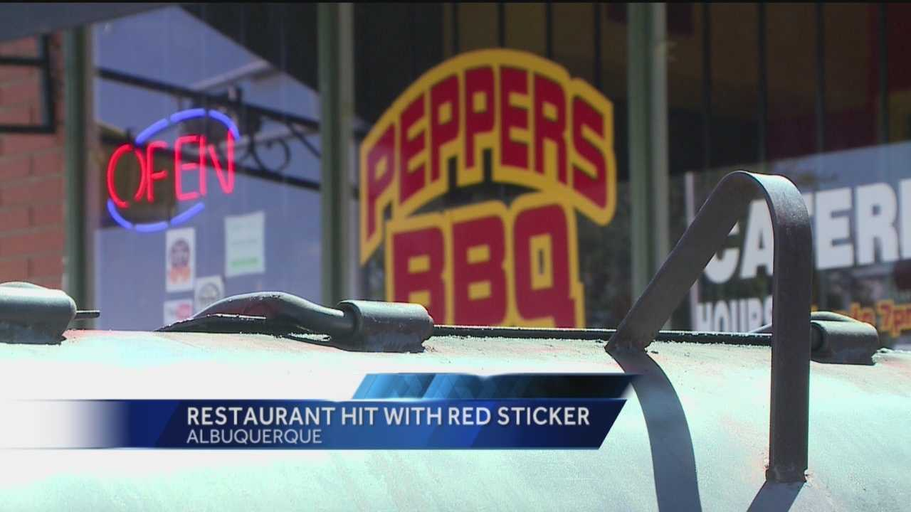 A red sticker at an Albuquerque Restaurant know for its barbeque.