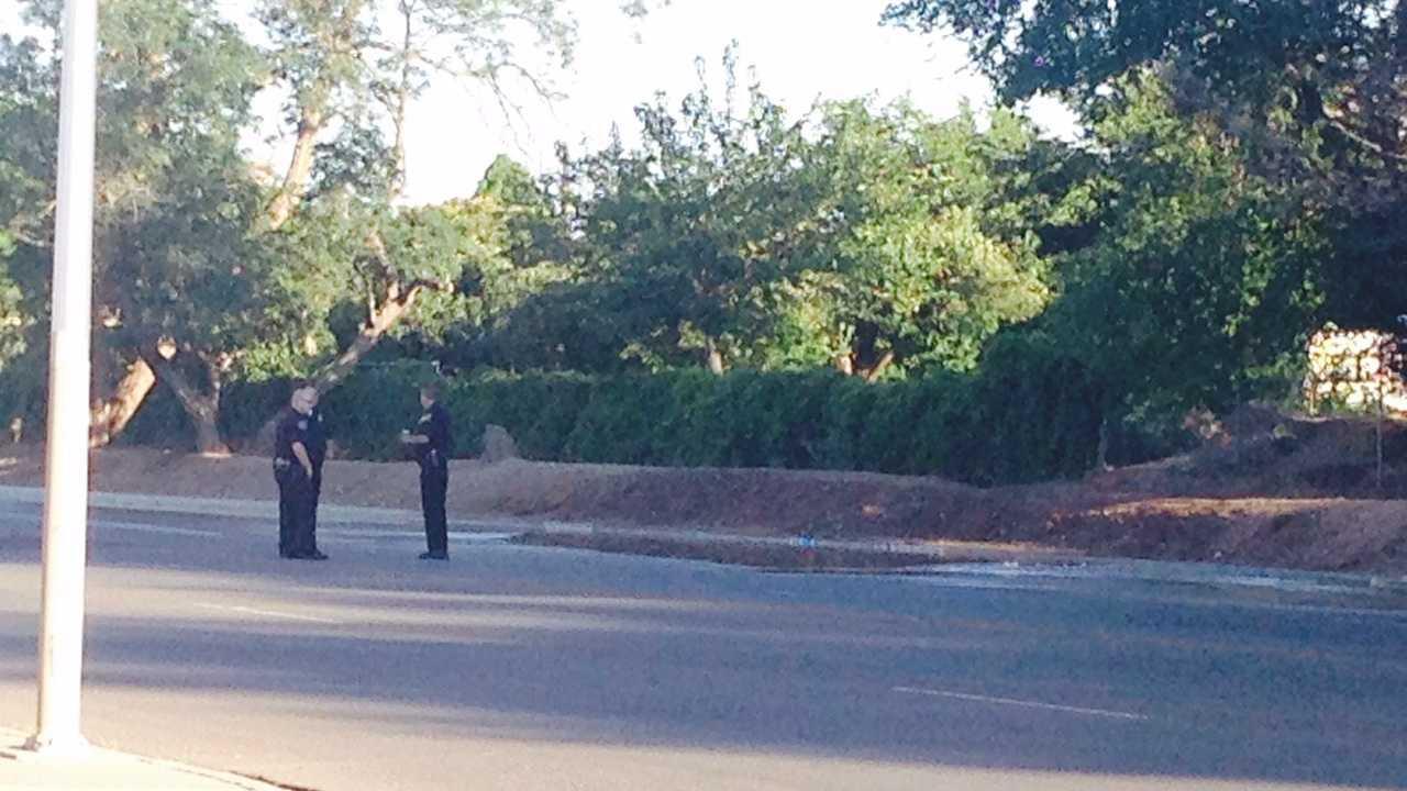Albuquerque police investigate a sinkhole Tuesday morning.