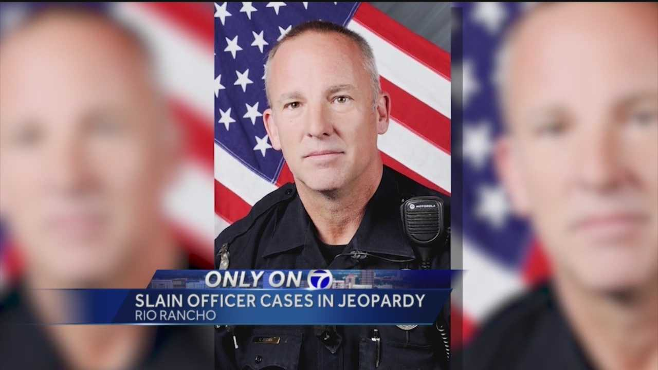 A dozen of a slain Rio Rancho officer's cases have been thrown out by a city attorney in the last two months.