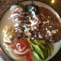 Mole stuffed, bacon wrapped green chile by u local user AngelAlvarezGuillen. CLICK HERE to see the recipe.