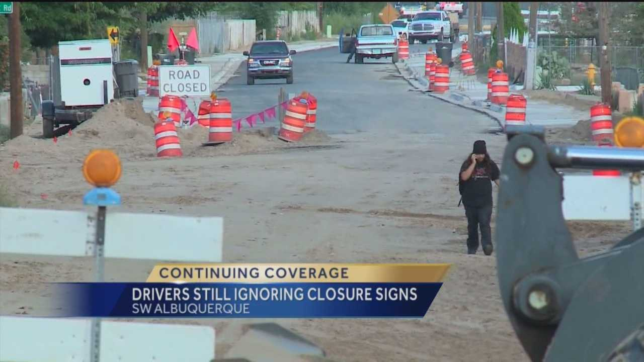 More headaches for families in a south valley neighborhood. People are moving detour and road closed signs and driving right through a construction zone.