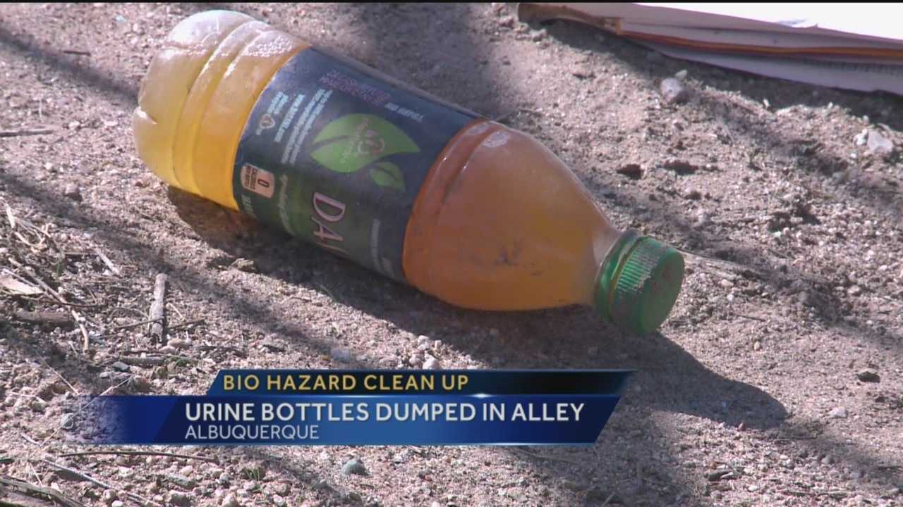 Hazmat crews spent Thursday cleaning an Albuquerque alley after someone dumped a pile of plastic bottles full of urine there.