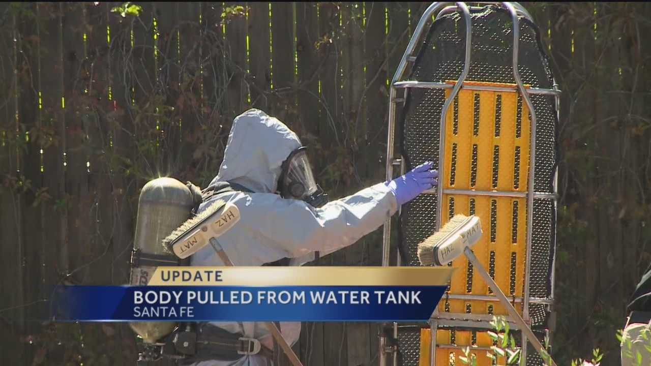 Law enforcement officials in Santa Fe have retrieved a body from a water tank behind the Lena Street lofts.