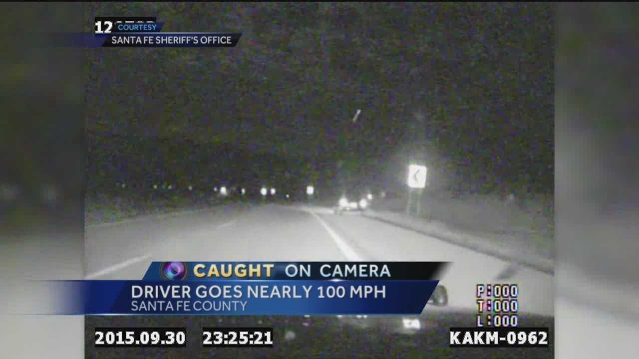Santa Fe Sheriff's dash cam video captures deputies in hot pursuit of a black car last month.