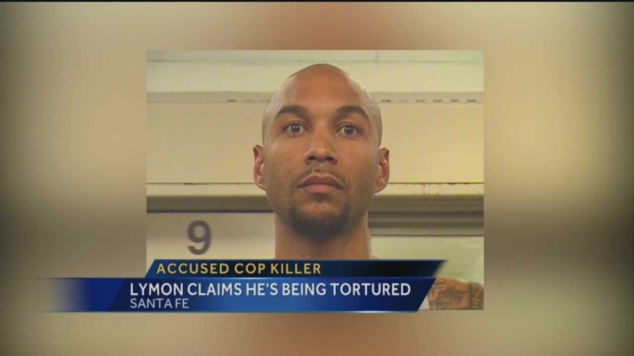 Accused cop killer claims he's being tortured