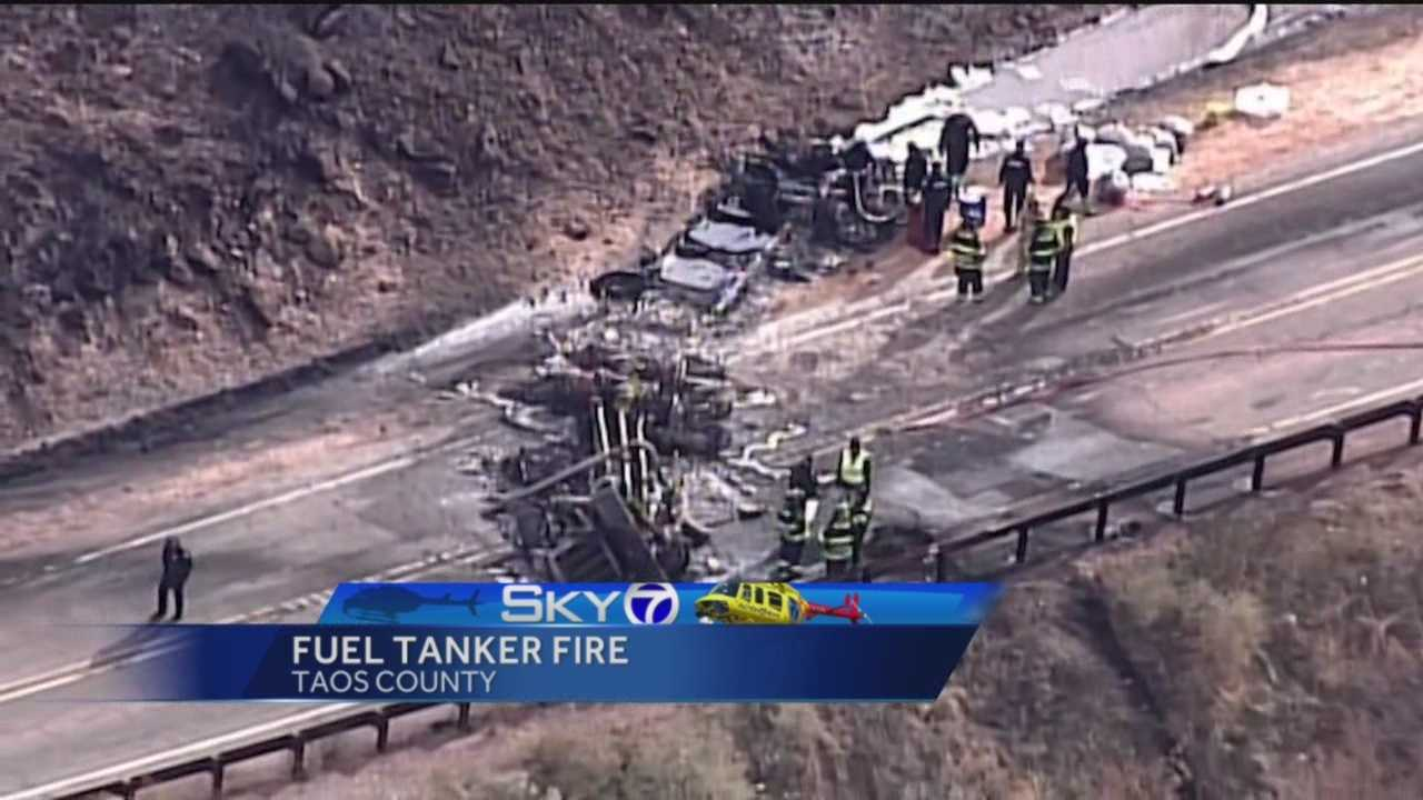 Crews are cleaning up a busy roadway in northern New Mexico, after a fuel tanker truck overturned and caught fire Monday morning.