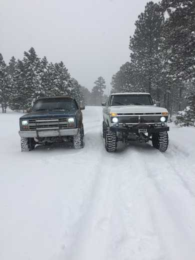 1977 Ford and 1985 Chevy in the snow on Mt. Taylor in Grants, NM.