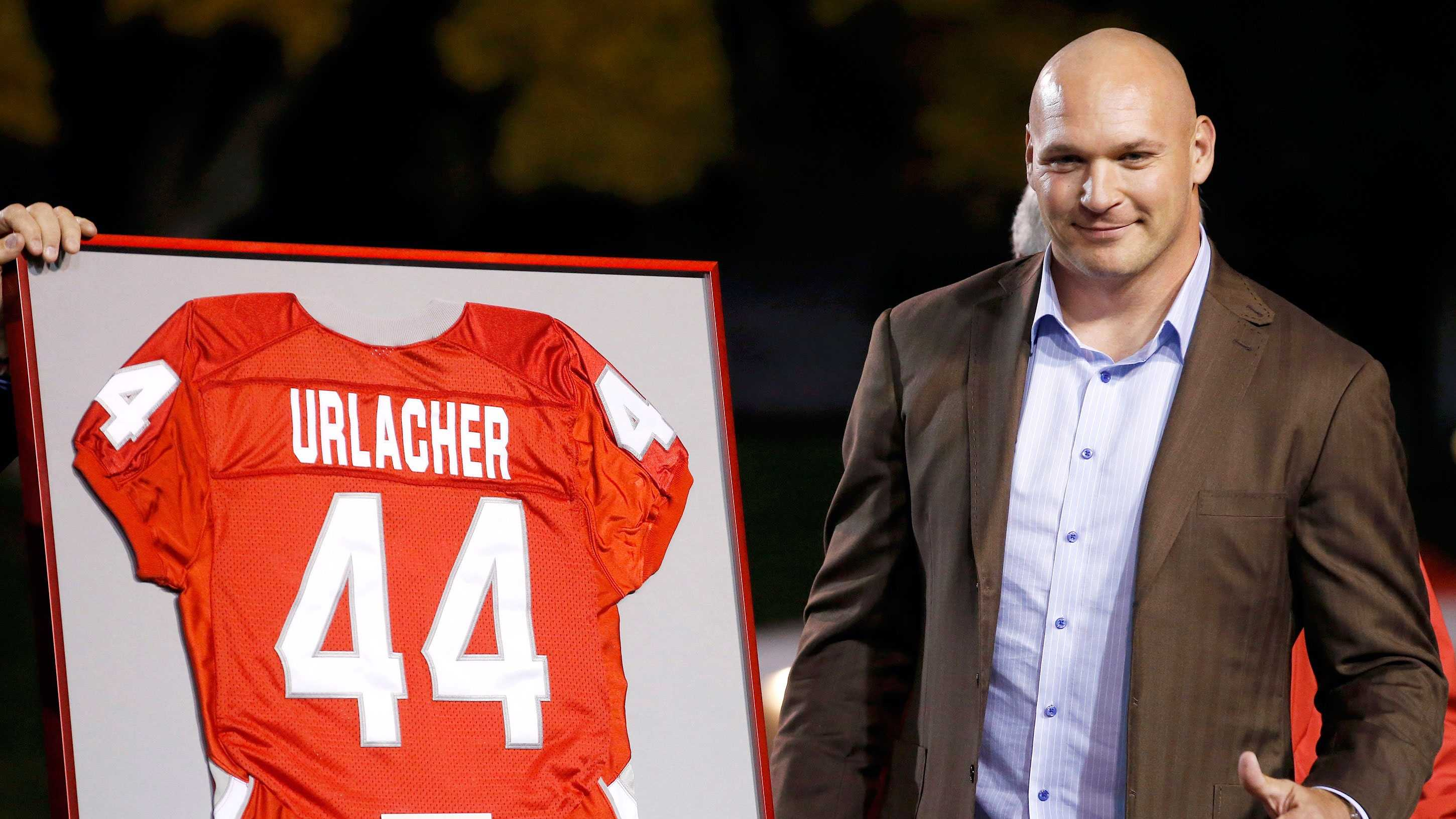 Former New Mexico and Chicago Bears football player Brian Urlacher gives a thumbs up as his jersey number is retired during a halftime ceremony at an NCAA college football game against the Air Force on Friday, Nov. 8, 2013, in Albuquerque, N.M. (AP Photo/Ross D. Franklin)