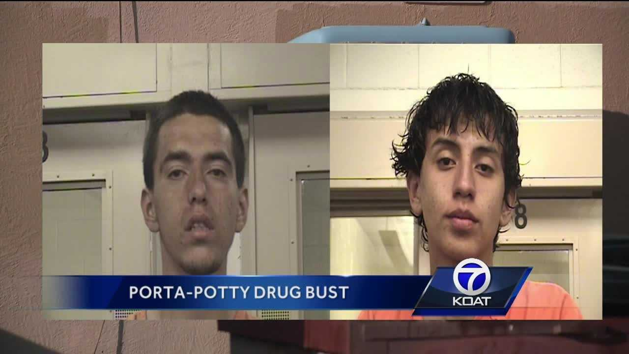 Two area men are accused of dealing drugs out of a portable toilet in the parking lot of an adult video store.