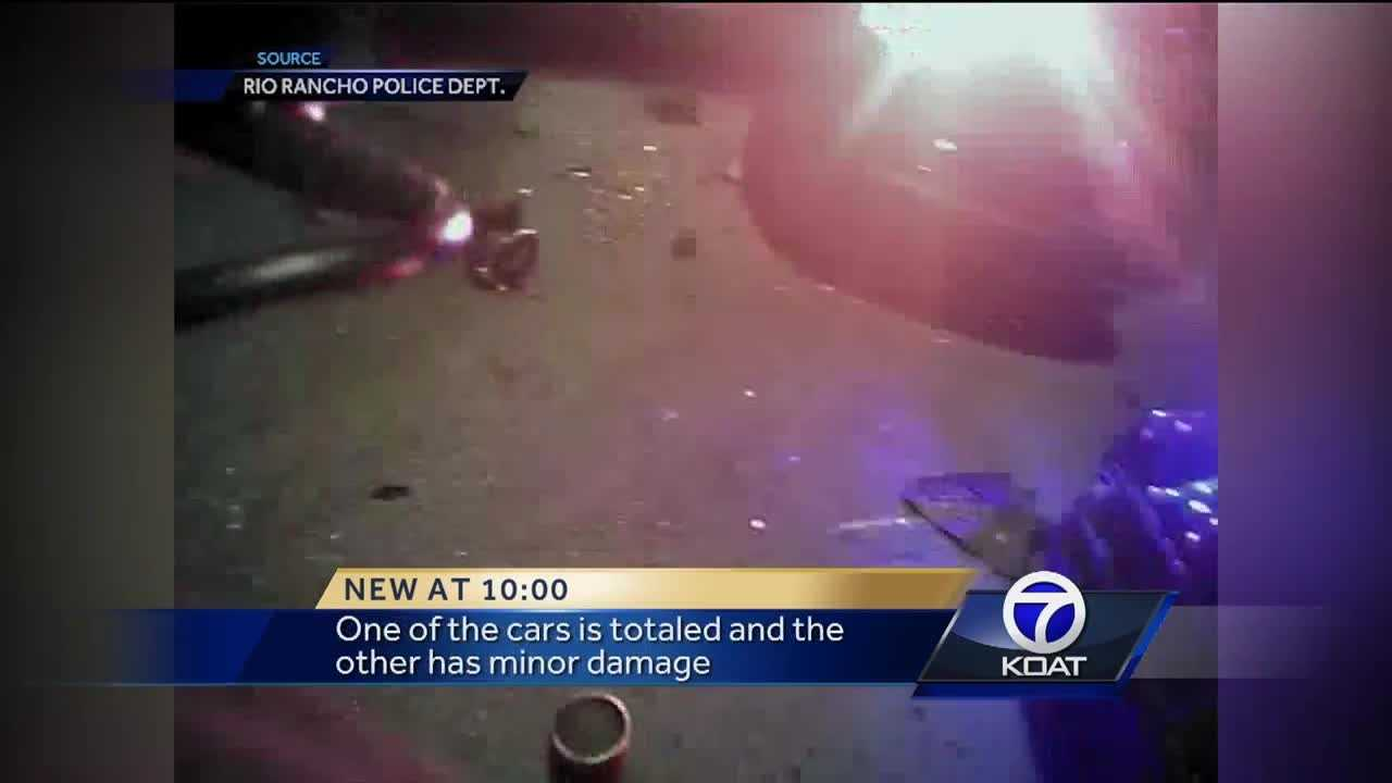 Two Rio Rancho police officers were almost hit by a man who they say was driving drunk. They jumped out of the way but their squad cars were totaled.