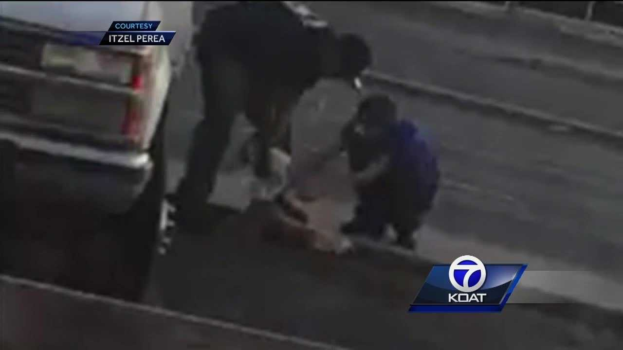 Police say video shows men cutting the tail off road kill in northeast Albuquerque.