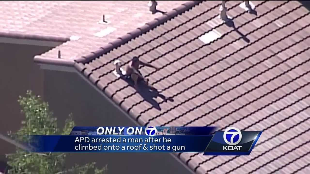 APD arrested a man after he climbed onto a roof and shot a gun.