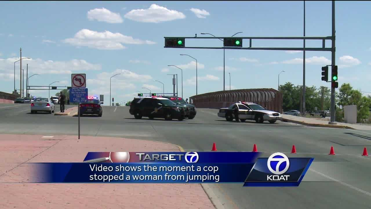 Cop stops woman from jumping off overpass