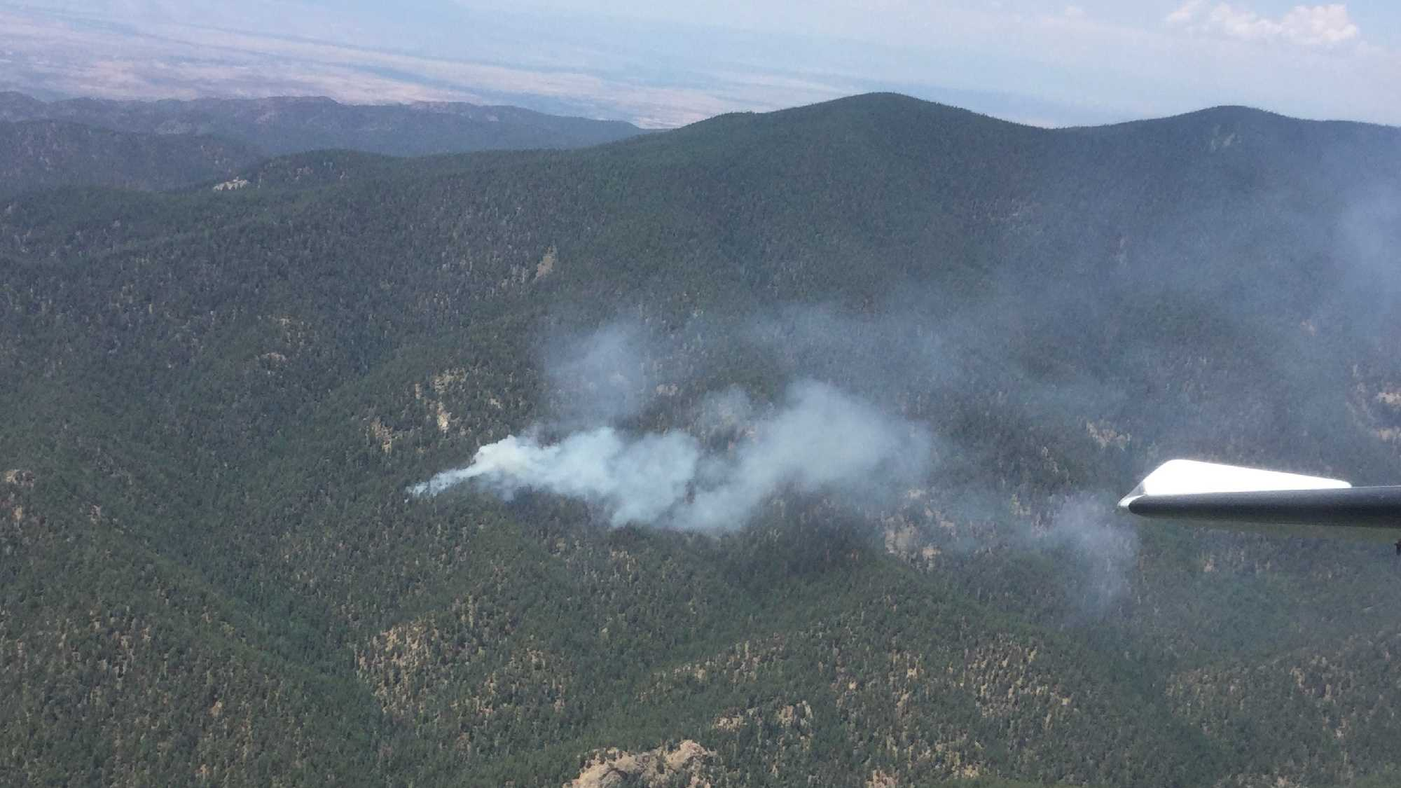 Fire officials are battling a fire in the Wilderness portion of the Santa Fe Municipal Watershed.
