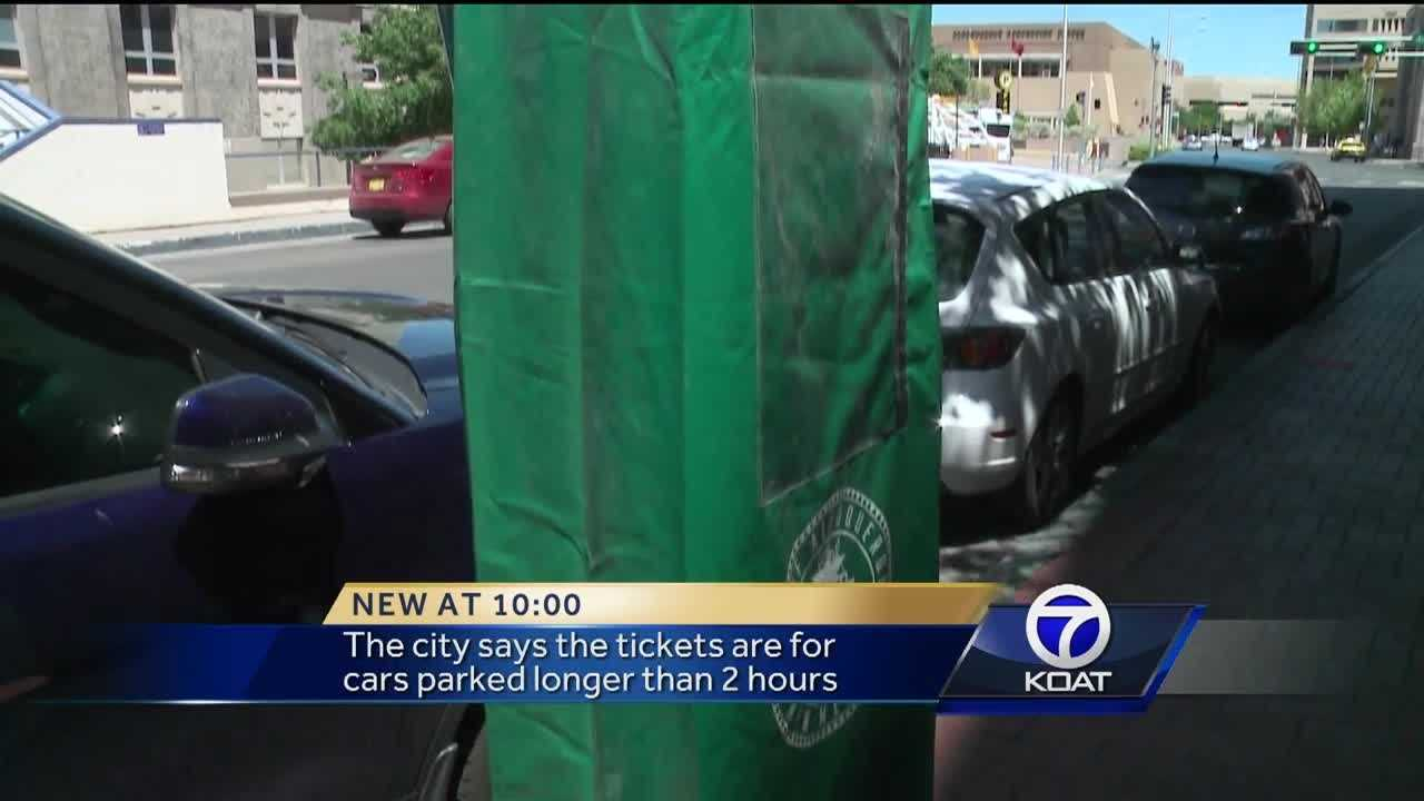 Drivers in downtown ABQ got tickets after finding the parking meter covered.