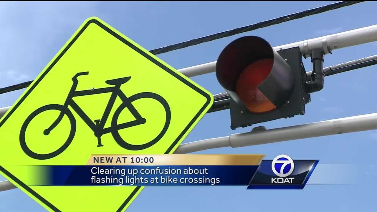 State law does not require drivers to stop at bike crossing lights.