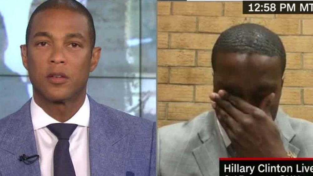 "Anwar Sanders, right, a New Mexico State Police officer stationed in Santa Fe, wipes away a tear during a recent interview with CNN anchorman Don Lemon about being ""a victim of both sides"" amid the conflict between African-Americans and law enforcement."