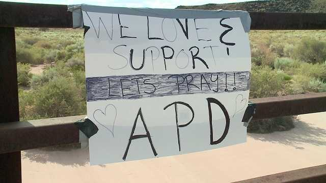 Police supporters respond to torn down signs by posting more