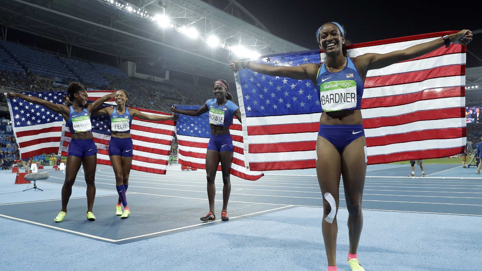 United States's Tianna Bartoletta, Allyson Felix, English Gardner and Tori Bowie celebrate winning the women's 4 x 100-meter relay final during the athletics competitions of the 2016 Summer Olympics at the Olympic stadium in Rio de Janeiro.