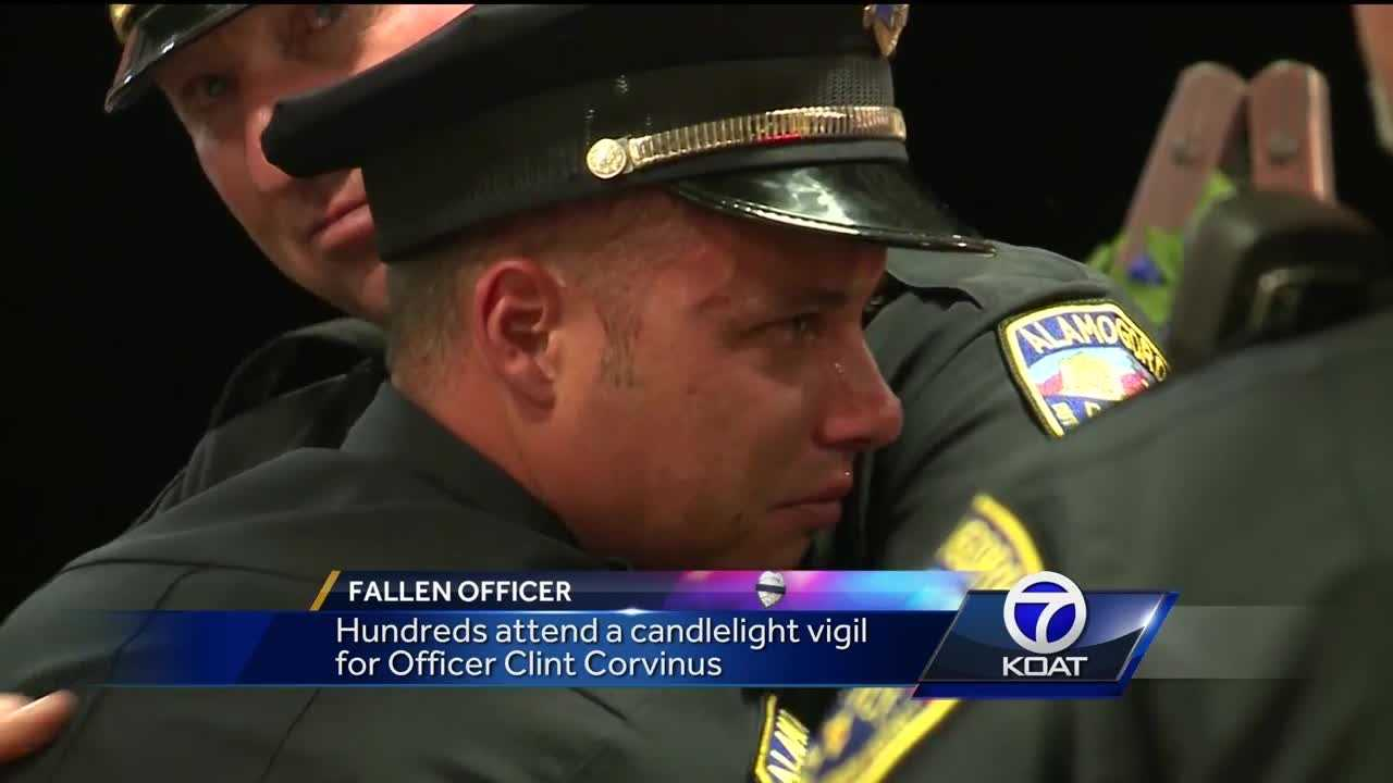 Hundreds attend a candlelight vigil for Officer Clint Corvinus.