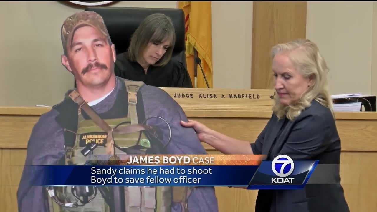 Sandy claims he had to shoot Boyd to save fellow officer but the state maintains Boyd was in the process of surrendering.