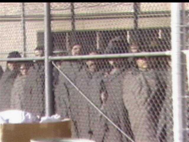 Inmates who feared violence fled outside to the prison fence where they could be in view of several police agencies and the National Guard.