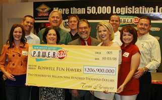 1. Nine players from the Roswell area split a $206.9 million Powerball jackpot. Carl and Holli Baldwin, Kevin and Jessica Breedyk, Ron and Cindy Miller, Ryan and Nicole Miller, Randy Miller