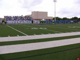 The teams lined up before the game to go through the starting line-up's.