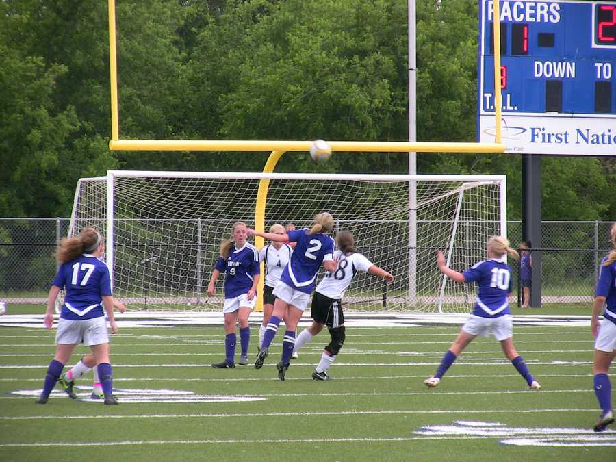 Bethany player Kami Bussert (purple) and Verdigris' Amy Crone (white) both try to position for the ball, but Bussert looks to have the edge and the potential header.