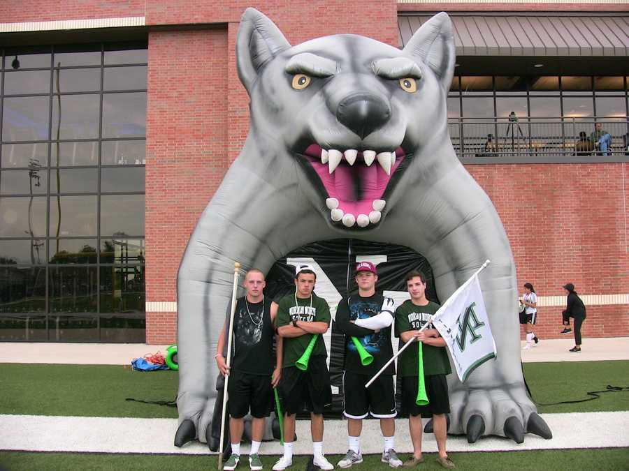 These Norman North fans are your die-hards. They lead the team onto the field for their battle against Union.