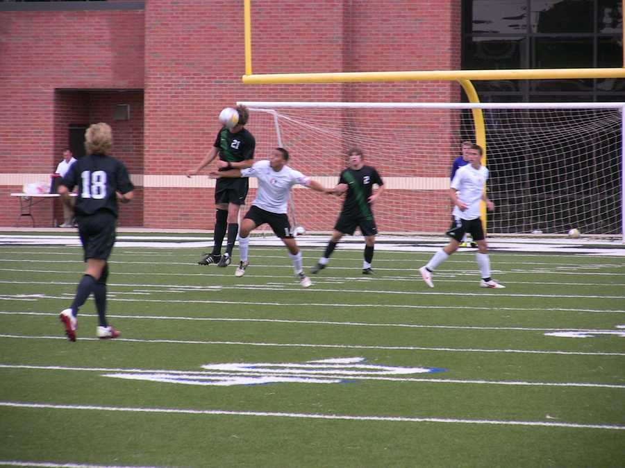 Norman North's Matt Kaufmann fights for position against a Union defender to give a header to the ball, trying to help serve it to a teammate.