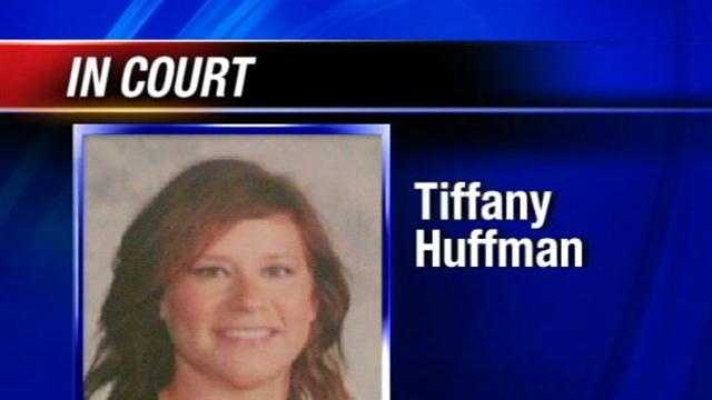 A teacher's aide charged with sending nude pictures to students will face a judge Tuesday.