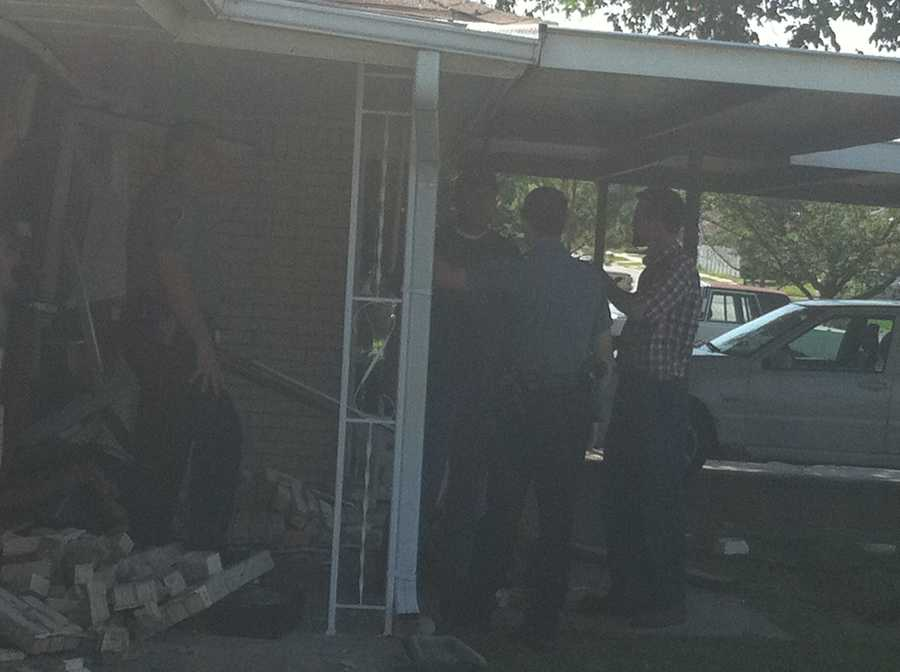 KOCO Eyewitness News 5's Carla Wade snapped these photos from a truck into a house at Southwest 59th and Western.