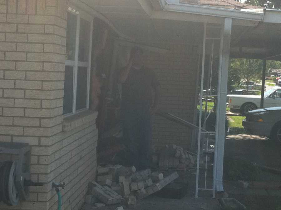 Police say an unlicensed teenager was behind the wheel of the pickup truck that hit this house.