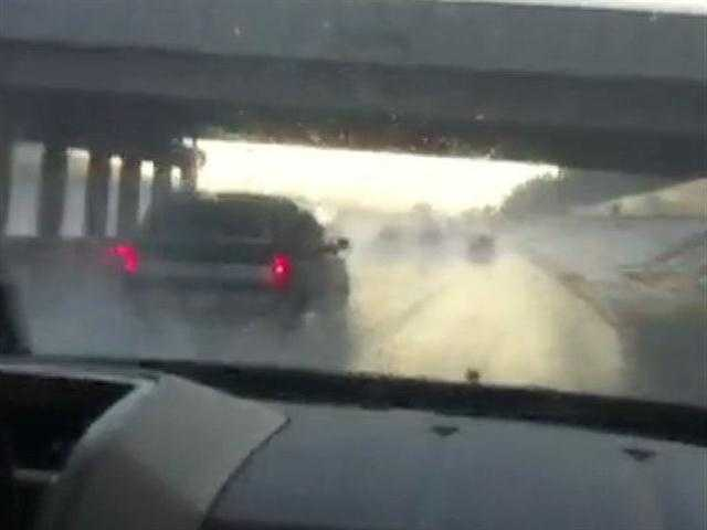 Reporter Kim Passoth captures video of rain pounding cars on Interstate 44 near Bethany.