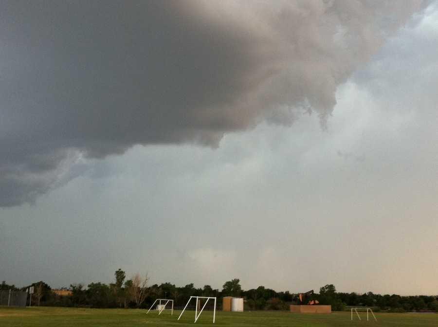 Dark clouds did start to form and storms develop near El Reno right around sundown.