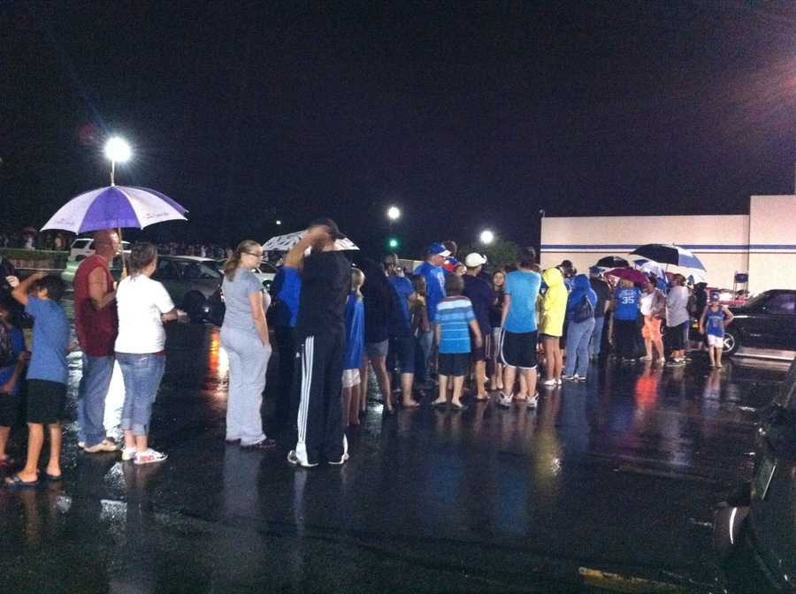 Fans lined up outside of Academy Sports and Outdoors stores late Wednesday for their first shot at championship tees.