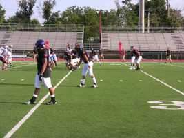 The Urban team (west) lines up pre-snap on offense.