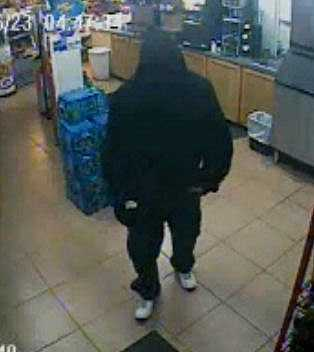 Enid police release surveillance photos from an armed robbery at the One Stop convenience story.