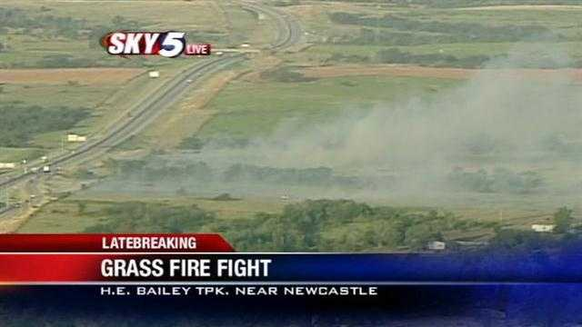 Firefighters are battling a grass fire near the H. E. Bailey Turnpike Tuesday morning close to Newcastle.