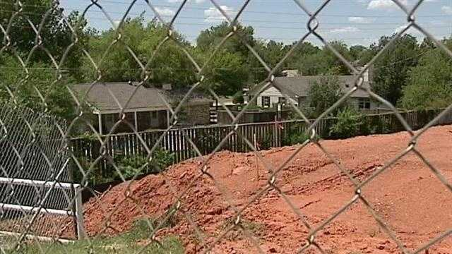 Construction on a gym at Nichols Hills Elementary school has been stopped after neighbors raise concerns about property lines and drainage.