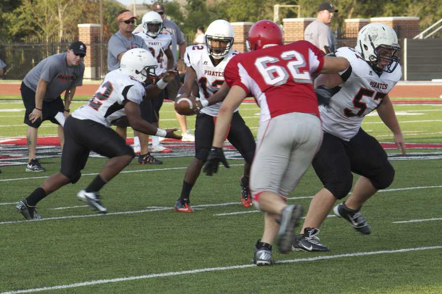 Pirates looks to a run play with a Yukon player looking to make his way to the backfield.