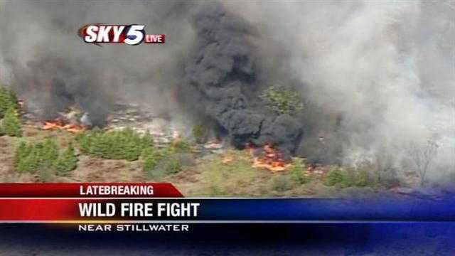 At least one structure was damaged Wednesday afternoon in a wildfire near Stillwater -- and Sky5 captured this video.