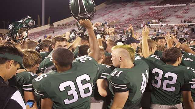 "The Norman North players break down at the end of the game chanting ""Family."""
