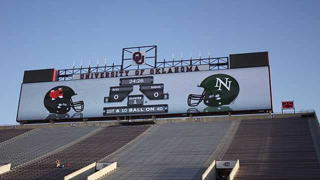 The scoreboard prepared with the logos of both schools.