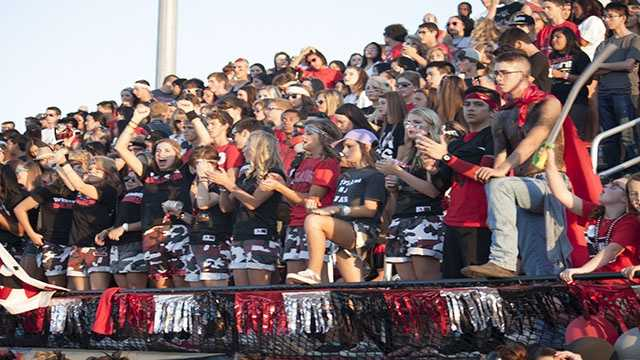 The student section for the Jaguars was filled with spirited fans who cheered on their team, which would go on to win their 12th straight 'Moore War'.