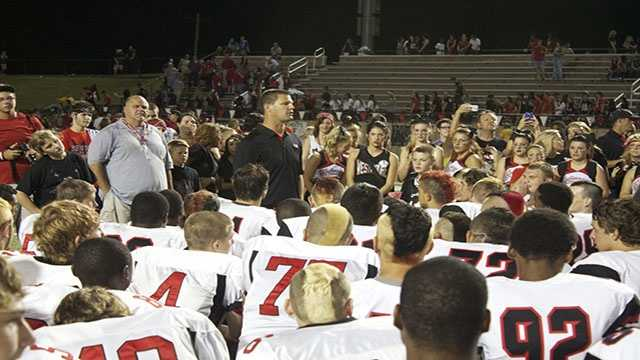 Jaguars head coach, BIlly Langford, talks to his game post-game after a victorious 'Moore War'.