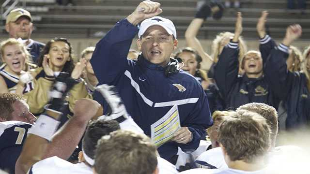 Coach Jeff Brickman shows his excitement of his Sabercats victory after double overtime against rival Westmoore in a post-game speech.