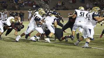 Southmoore running back, Karltrell Henderson runs through a hole made by his linemen. Henderson scored the first points of the game to give his team a 7-0 lead earlier in the contest.